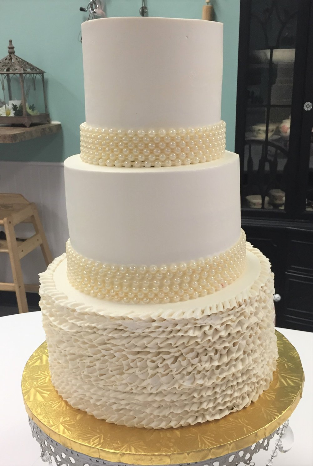 buttercream ruffles and rows of fake pearls wedding cake.jpg