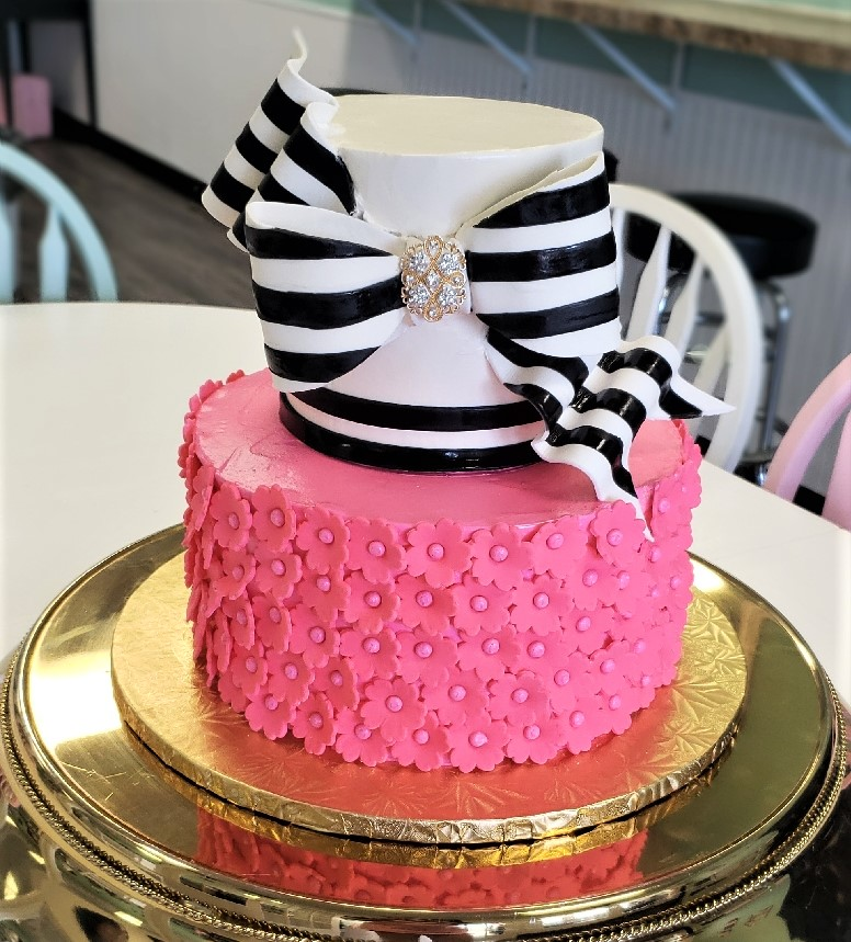 black and white striped bow cake hot pink flowers.jpg