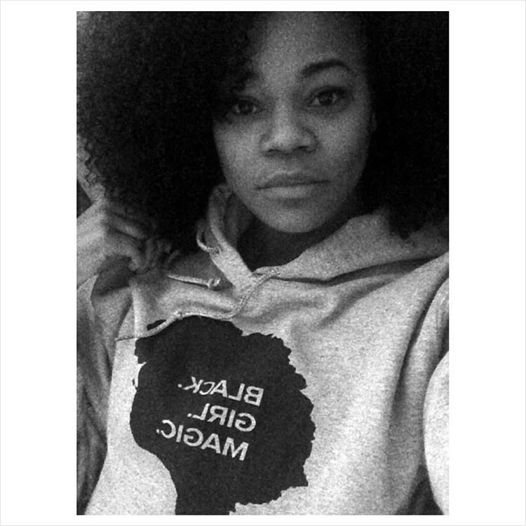 Pictured in BGM: Black Girl Magic Solid Hoodie in grey .