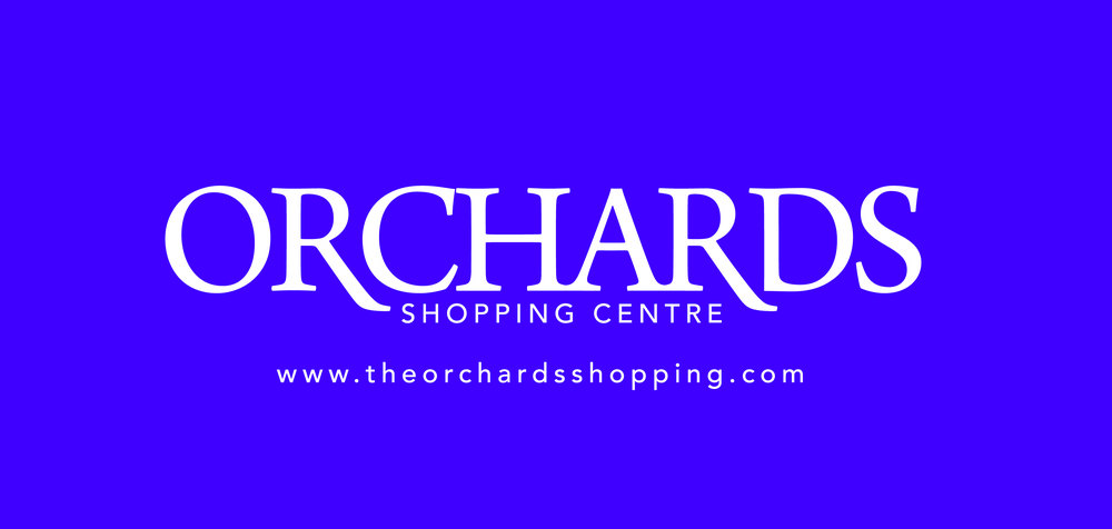 Orchards_cmyk_reversed_logo.jpg