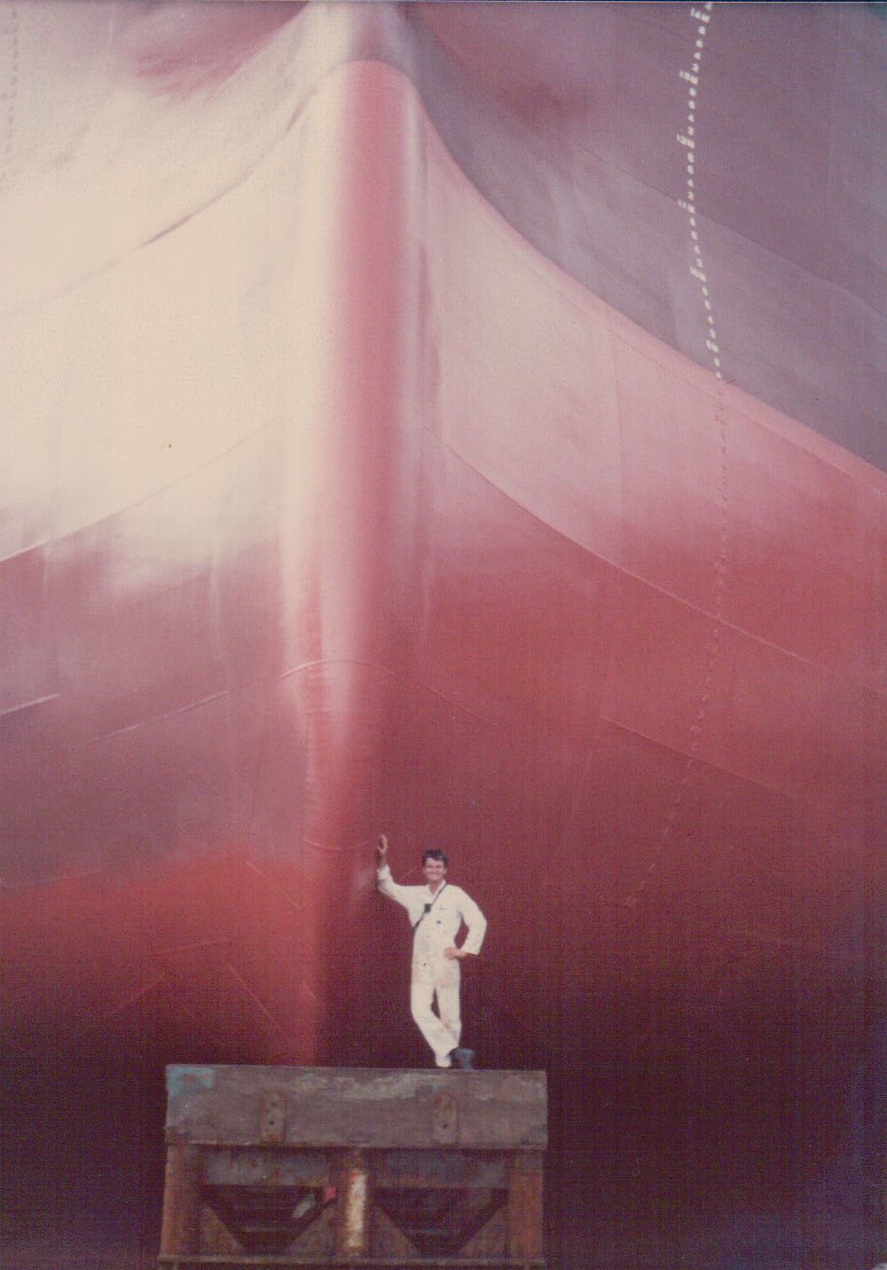 Leaning against the Nivosa's bulbous bow