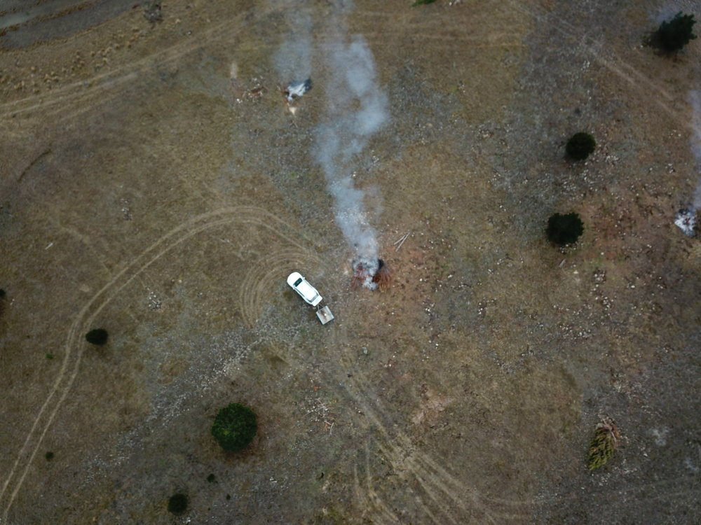 Drone view of a weekend burning dead wilding pines