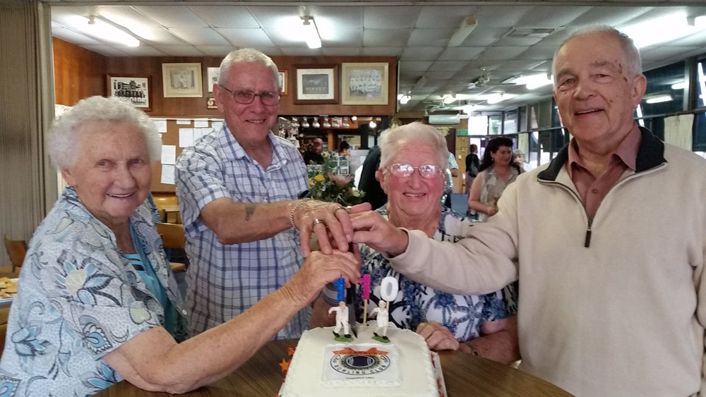 Life members cutting our anniversary cake.jpg