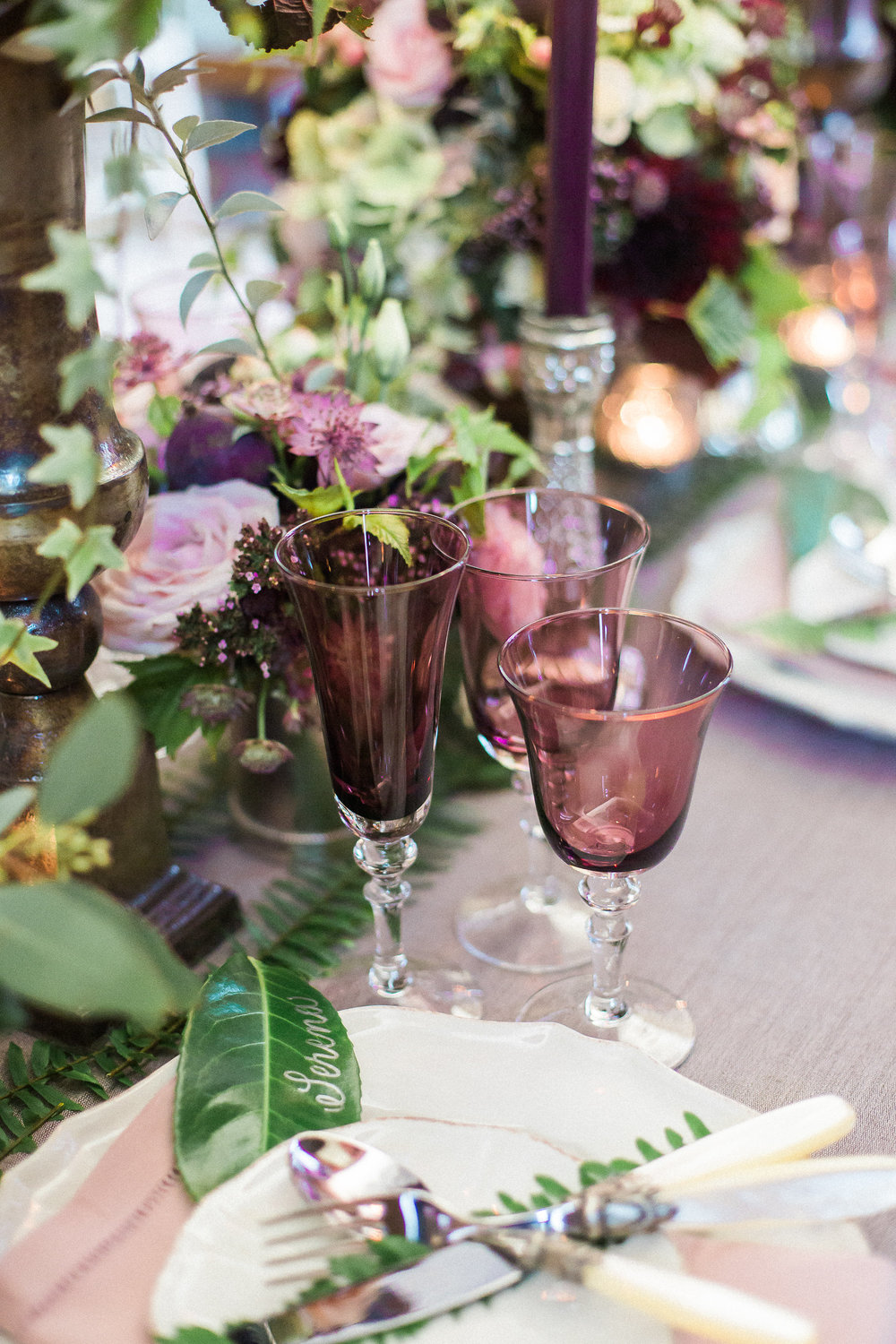 wedding reception table dark purple foliage fern