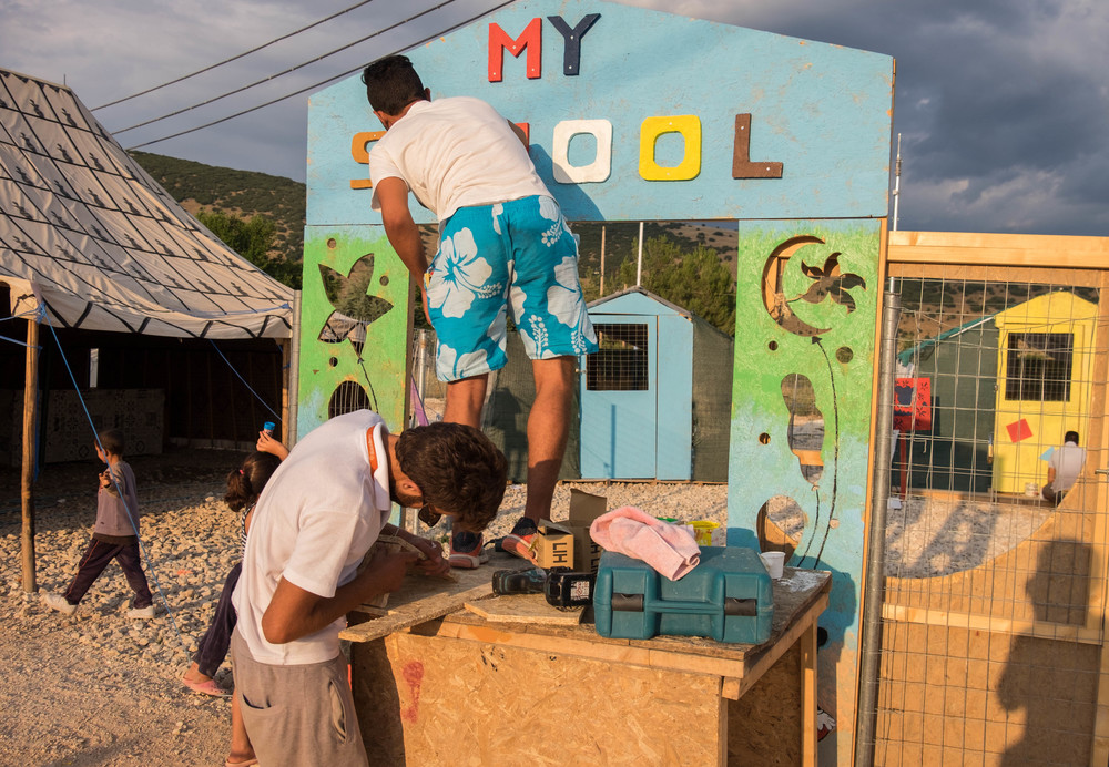 Syrian fashion designer Nur bottom, and railroad engineer Basim fashion new additions to the school structure following designs discussed by the construction and school teams. (Lucas Bertoldo / Lighthouse Relief)