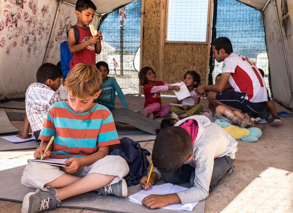Children return to their books in a classroom at the Lighthouse Relief school in the camp, where 570 asylum seekers are currently residing. (Lucas Bertoldo / Lighthouse Relief)