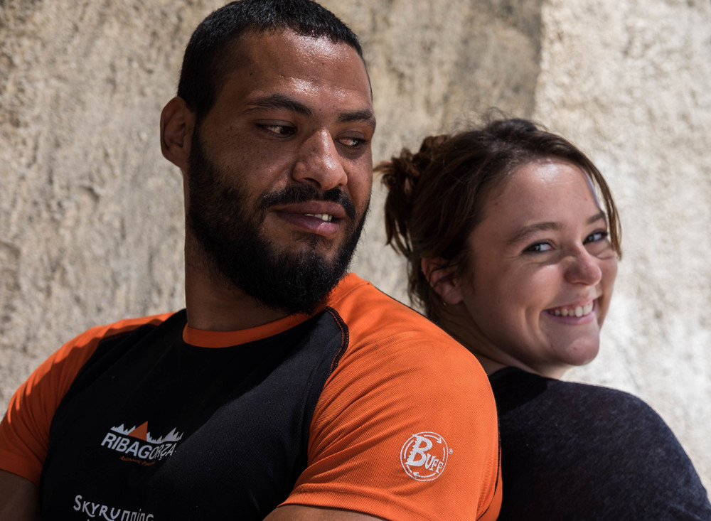 Qusai, a discus thrower from Syria, and Kennedy, a discus thrower from the United States, take a break from their training together at Katsika refugee camp. (Lucas Bertoldo / Lighthouse Relief)