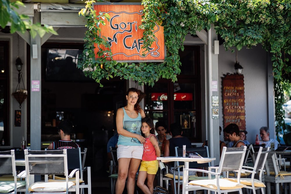 Toula and her daughter in front of her Goji Cafe. (Arif Nurhakim / Lighthouse Relief)