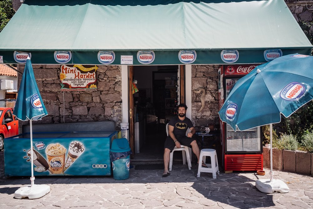 Stratos in front of his Mini Market in the town centre. (Arif Nurhakim / Lighthouse Relief)