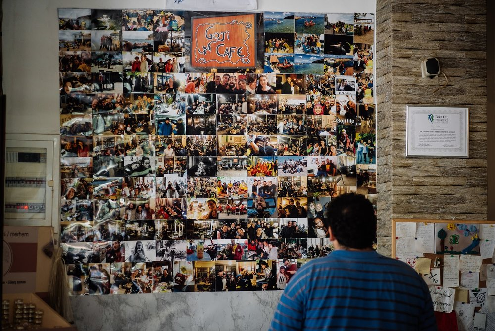 The photo wall that Toula made in her Goji Cafe. (Arif Nurhakim / Lighthouse Relief)