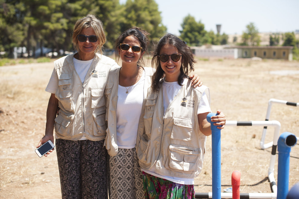 Mercedes, Mariana and Manuela Bahamón working on their collective family effort to improve Ritsona refugee camp.