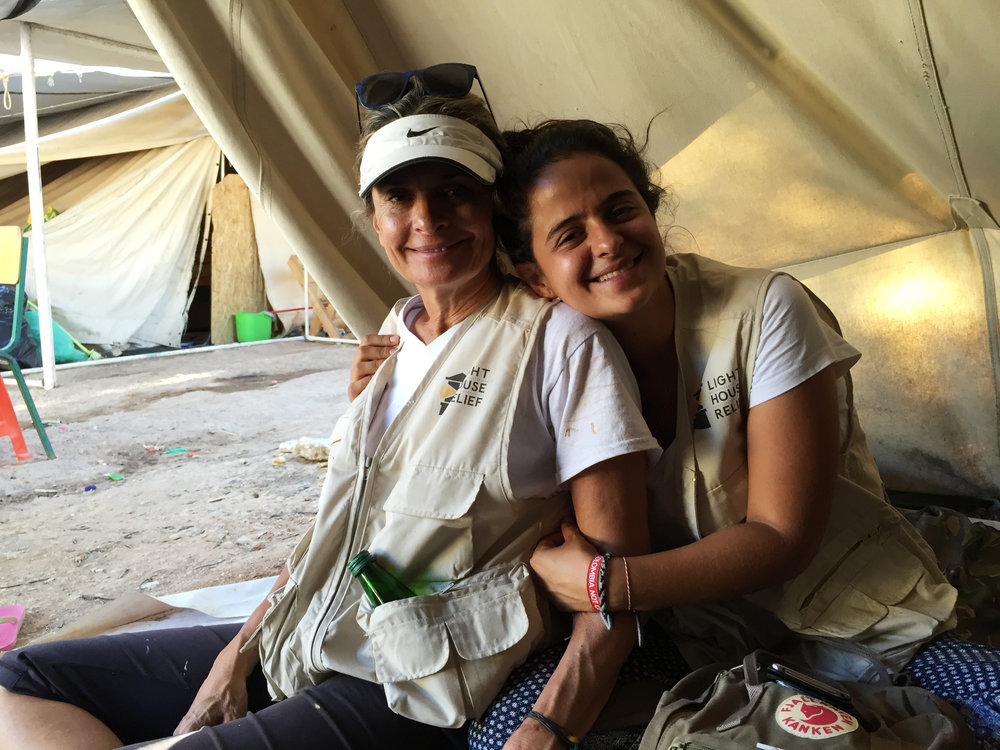 Protection Coordinator Mariana Santoyo Bahamón re-energises with her mother Mercedes in a tent at Ritsona refugee camp. (Tracey Thiele / Lighthouse Relief)