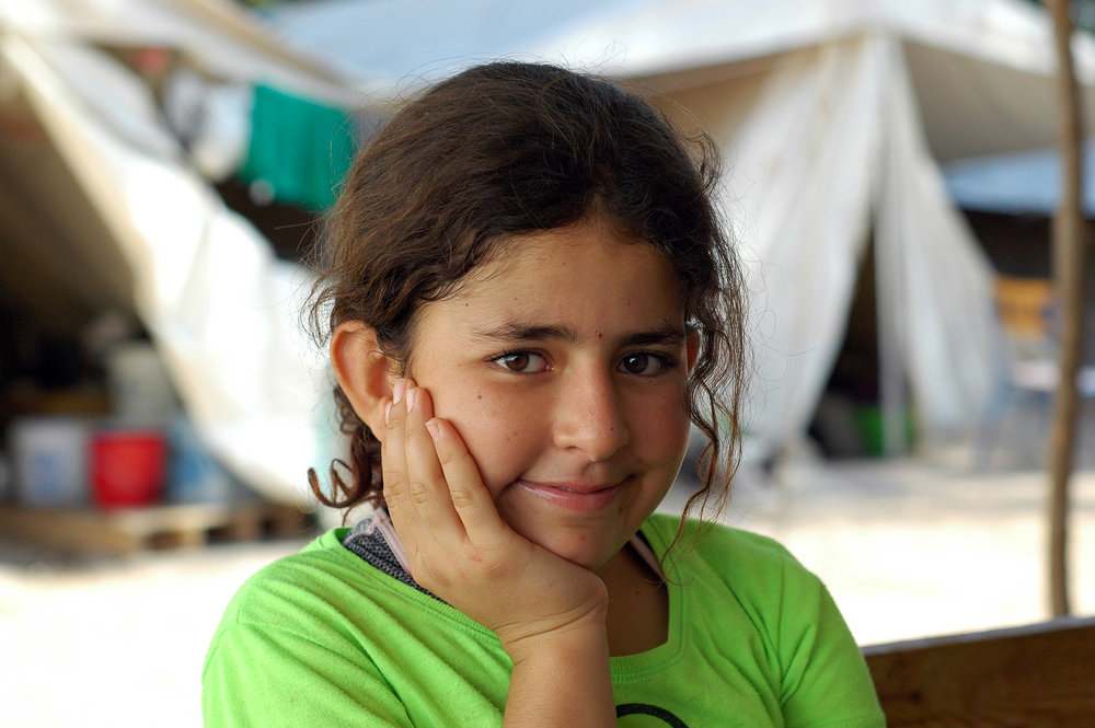 "Berivan, 12, from Kobane, Syria If there's anyone in the camp who's confident about the future, it's Berivan. ""Since I was eight I have known I'm going to be an eye doctor,"" she says. ""I love eyes, because they show feelings. I've seen so many sad eyes."" She whips out a pencil and draws a diagram of an eyeball with a tear duct next to it. ""Did you know that when people cry, it comes from a sack next to the eye?"" She pauses and points to her chest. ""Of course, it also comes from the heart."" Berivan's family will be leaving the camp soon to continue their asylum process in Athens, a move that she has mixed emotions about. ""I won't get to see my friends as much, because they'll be too far away. But I also won't have to see any more bugs or rats."" She shudders. ""I hate rats."" Photo: Allison Voigts/Lighthouse Relief. Posted Oct 10, 2016"