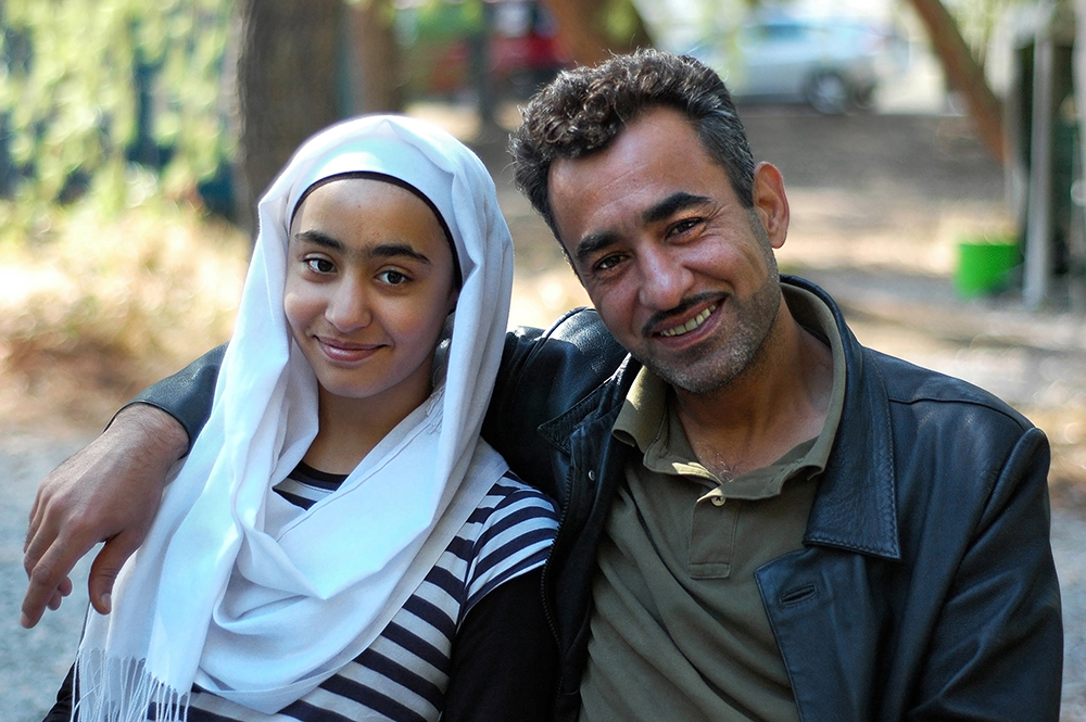 "Yousef, 43, and his daughter Zena, 12, from Idlib, Syria ""Simply put, I left for my kids,"" says Yousef. After years working in hotel management for Sheraton in Damascus and Saudi Arabia, the father of four had saved his earnings and started a dairy factory in Idlib to be closer to family. One day the Syrian Army attacked their town, killing scores of people and wiping out neighbourhoods. The family happened to be in Damascus at the time; both the factory and their house were burned. ""Why? I don't know,"" he says. He and his wife, Hanan, moved the family from town to town in the years that followed, looking for a place that would be safe from bombings. Ultimately they decided they had to leave Syria this year. ""It isn't 10 or 20 bombs, but hundreds,"" he explains. ""It's all charcoal now."" Photo: Allison Voigts/Lighthouse Relief. Posted Nov 3, 2016"