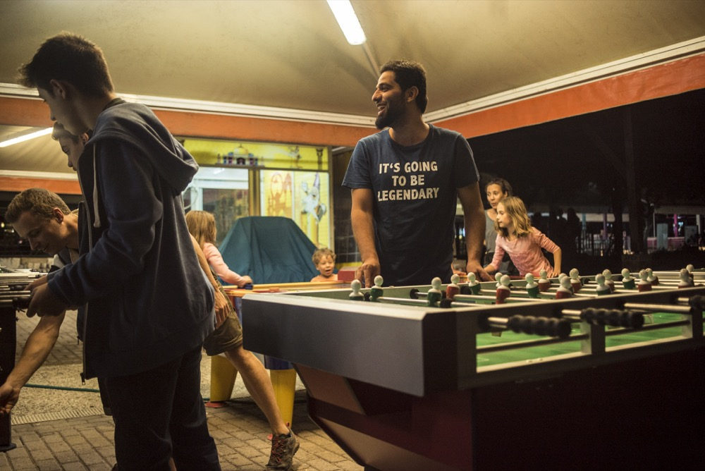 Sulaymaan playing pool in Chalkida with his friend. Photo: Tommy Chavannes/Lighthouse Relief