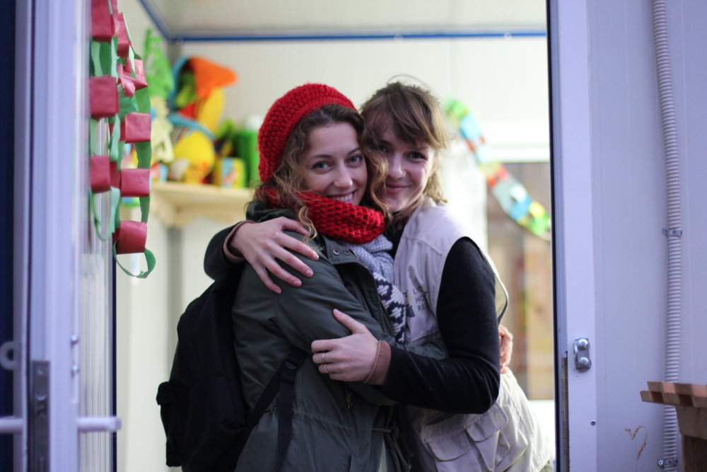 IYCF Supervisor Nina Adelaide (right) and Julia Kende, Gender Based Violence Protection Officer (left) in the doorway of the MBA at the end of the day. Julia's hat was knitted by the MBA's resident knitting expert. Photo: Marie-Helene Rousseau/Lighthouse Relief