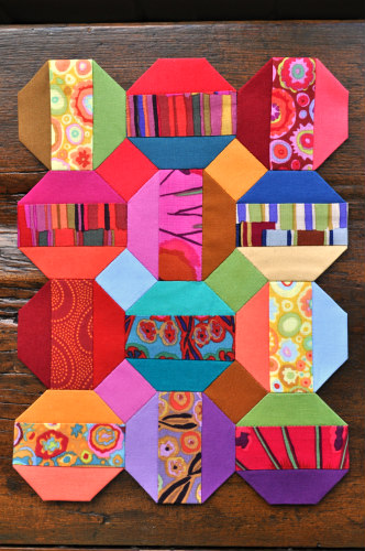 A lively combination of Kaffe Fassett prints and Cotton Couture solids by Michael Miller Fabrics.