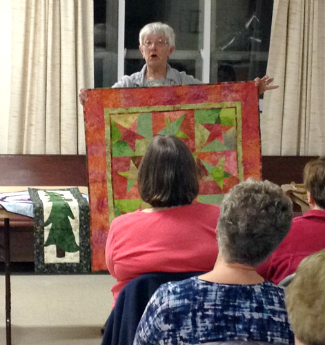 Kitsie Demeree with one of many of her beautiful quilts.