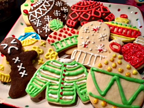 ABC Gingerbread Men and not-so-Ugly Sweaters share a plate with more traditional cookies.