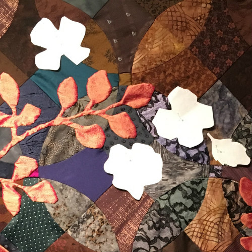 For this quilt, loose paper cut shapes helped determine the composition before the final shapes were cut from silk.