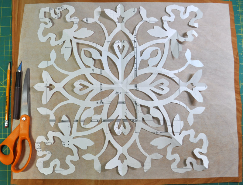 The final paper cut design ready for transfer to fusible web, which had already been adhered to fabric. When cutting, I first get my head in the right place: patience, steadiness and staying in the flow.