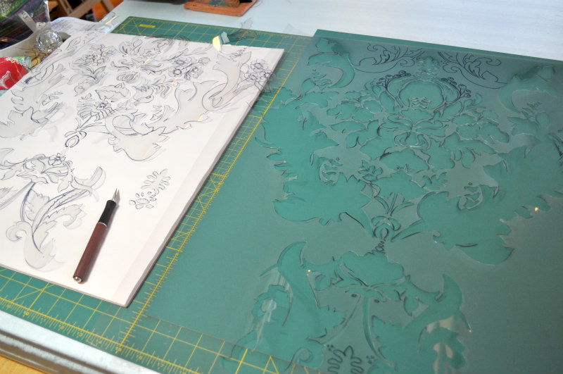 Cutting the damask pattern.