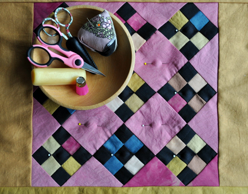 Bird's eye view of my mini quilt and trusty tools.