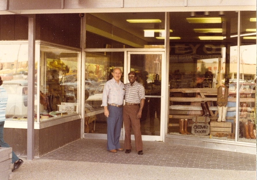 Moss Deyong and Nelson Boyd in front of Deyong's Location in Newmarket South Shopping Center