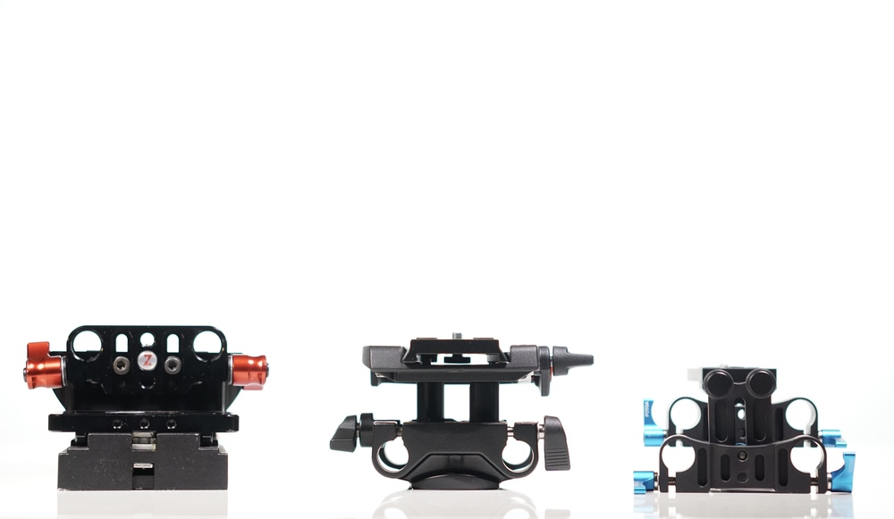 Left to right: Zacuto, Sachtler and FOTGA. They all use 15mm rods, they all rise to about the same height -- but that's pretty much where the similarities end.