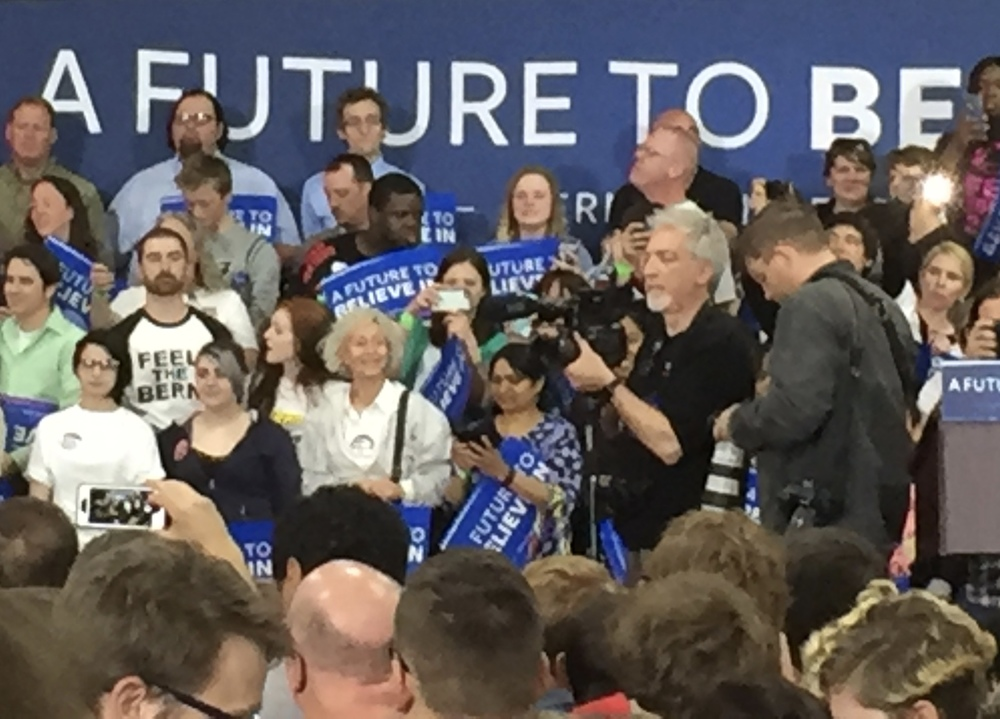 At the April rally. That's the FS5 with kit lens on a Benro Monopod. This image was captured on an iPhone 6 and cropped like heck. Sure the IQ is poor -- but not poor enough to prevent anyone from seeing what's going on.