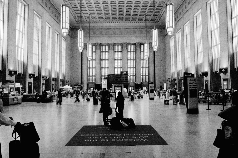 30th Street Station, Philadelphia. Sony a6300 with Zeiss Batis 18mm f/2.8: ISO 6400, f/7.1 1/1000th. No perspective correction, but obviously I converted to B&W, where I find the noise less objectionable.