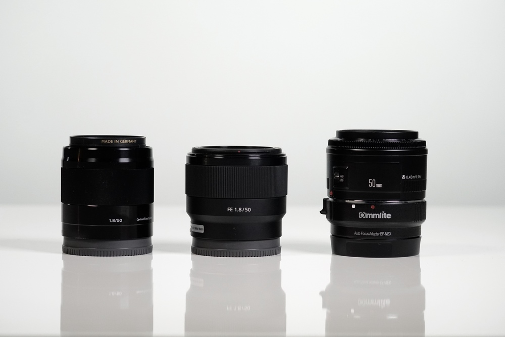 Left to right: Sony E 50mm f/1.8, Sony FE 50mm f/1.8, Canon EF 50mm f/1.8 with Commlite adapter. I wouldn't recommend the last combination - autofocus on a Sony body with any adapter just isn't great - but the real standout here is the E 50mm f/1.8 if you're using a crop-sensor body like the a6300.