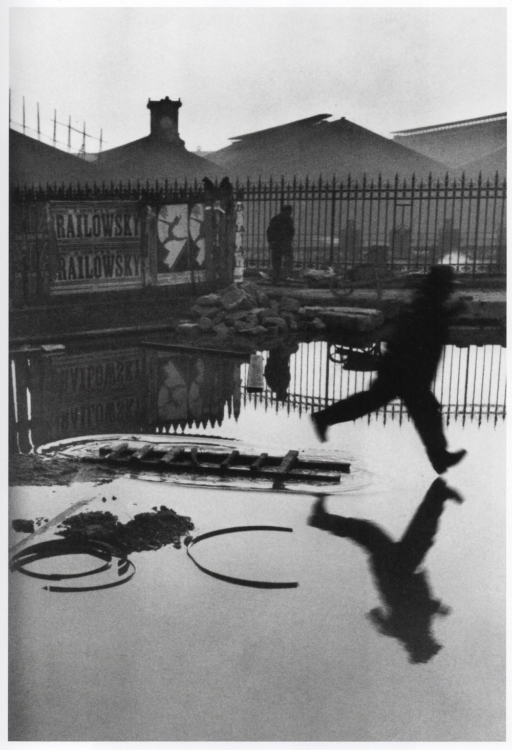 "Fair use: THIS is a decisive moment, one of the most famous by the photographer who coined the phrase, Henri Cartier-Bresson. Copyright 2010 Henri Cartier-Bresson/Magnum Photos.  Scanned from ""Henri Cartier-Bresson The Modern Century,"" Copyright 2010 The Museum of Modern Art. The RX100 Mark V is a radically superior image capture machine compared to the Leica with which Cartier-Bresson took this photograph, but in the end this grainy, slightly blurred image taken almost 85 years ago proves that it's not the machine, it's the person. And that technical perfection is NOT always the goal."