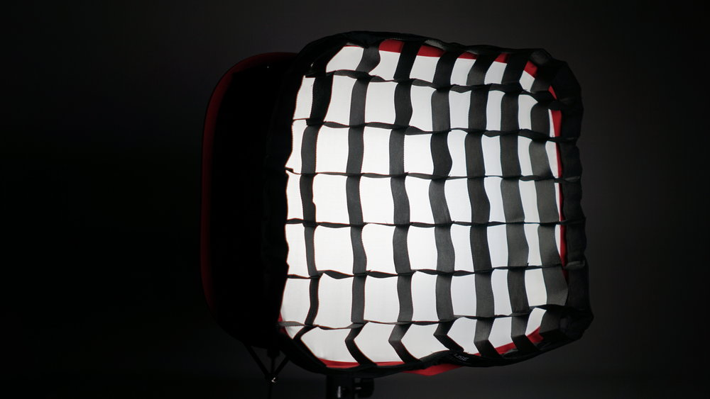 The D-Fuse grid works and is very easy to put on.  The Aputure Grid has more structure, but the net effect is the same.