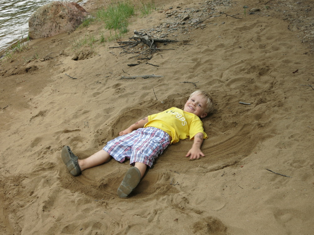 Playing in the sand next to the river