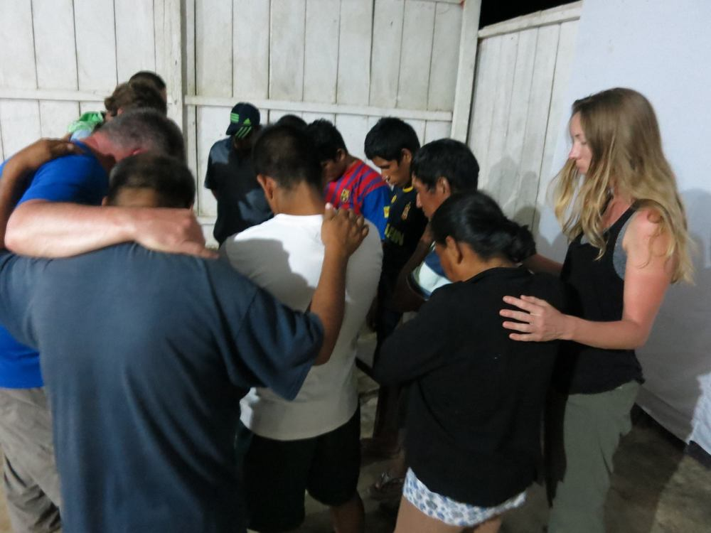 Neil & The Team praying over the men and women who made professions of faith