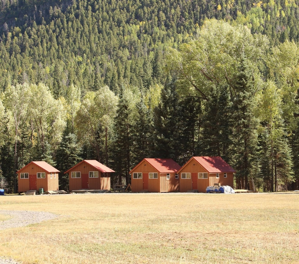 Red roofed cabins at camp