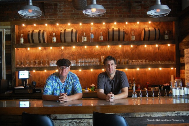 John Sharp and Jimmy Sharp, the father-son duo who spearheaded John Emerald Distilling Company, casually sit at the bar, which officially opened its doors in 2014.