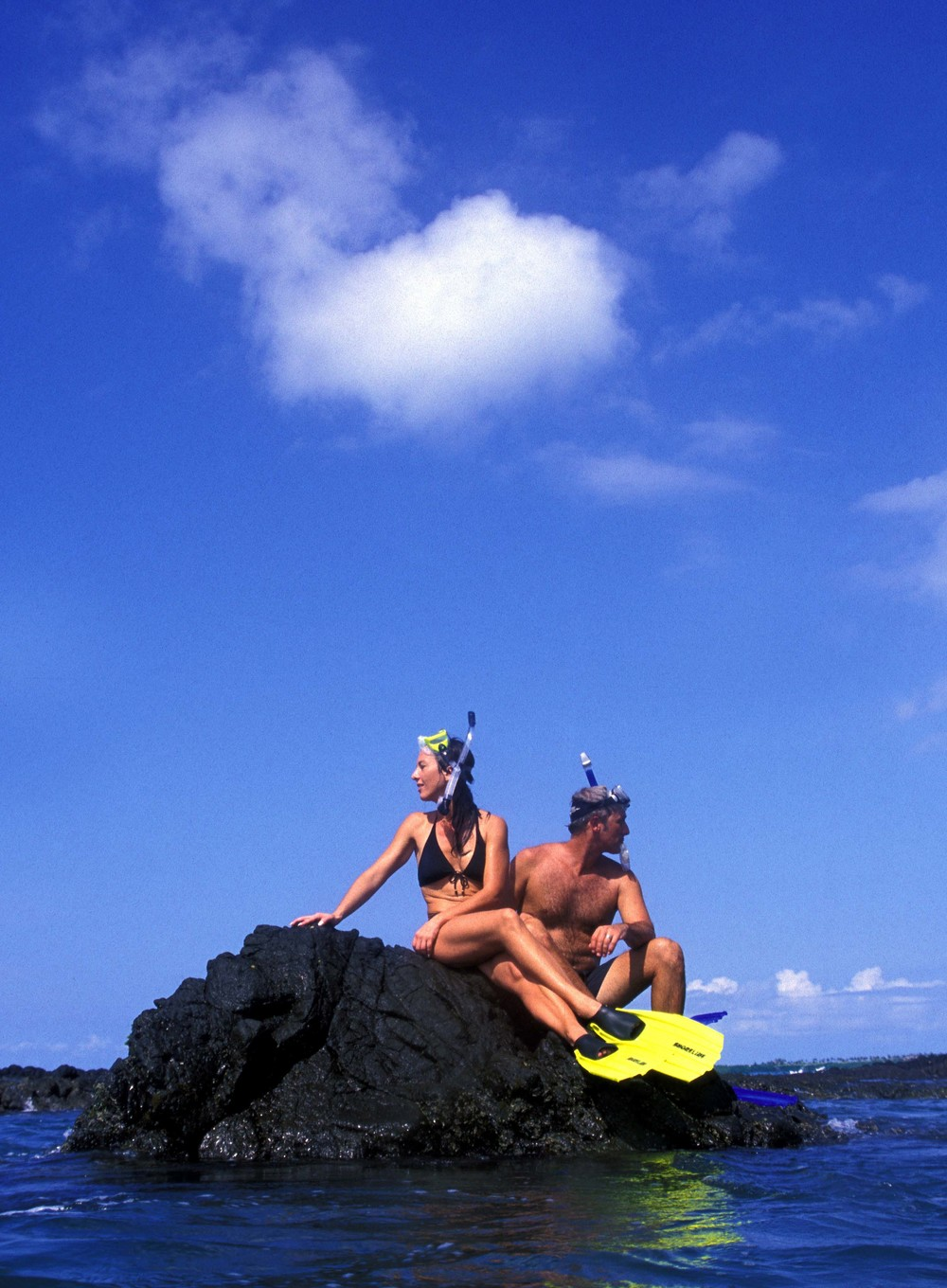snorklers on rock.jpg