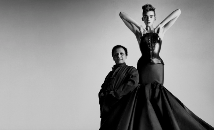 Azzedine Alaïa with one of his couture pieces