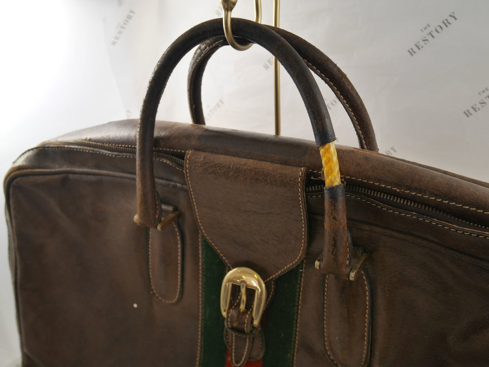 Before: broken handles on the Gucci suitcase