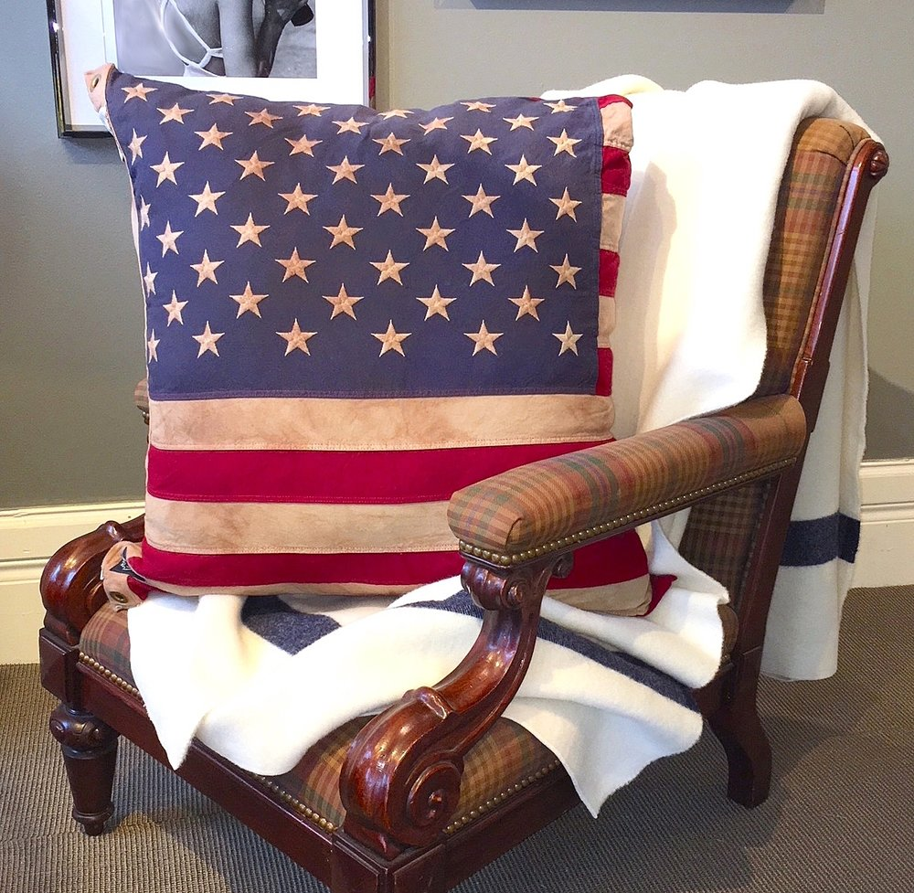 Vintage Flag Pillow - $164Hand Sewn in Detroit, our oversized Tea Stained flag pillows are bold and beautiful. Use indoors or out with a poly-blend filled pillow insert.Approximately 30 x 30 inches.Made of 100% Cotton. Zipper on one side for easy on and off and washing. Machine washable.Made in the USABUY NOW