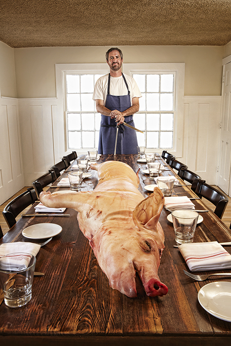 Chef Kevin BInkley with Pig For blog.jpg