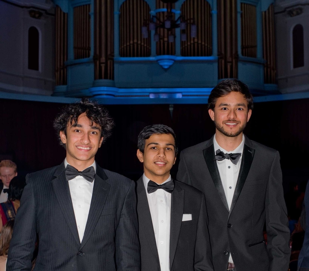 Jasmeet (right) with classmates at an event with the Cambridge University India Society