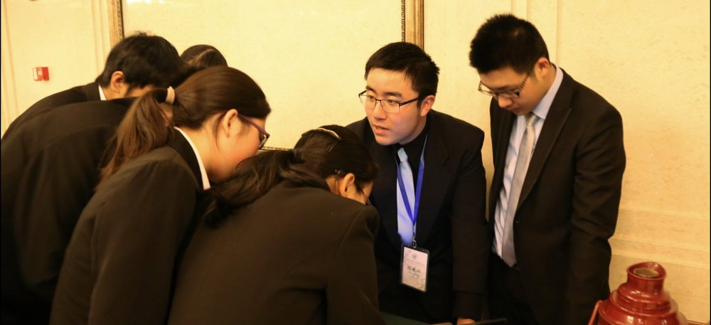 Xilin is pictured drafting a resolution at PKUNMUN, a Model UN conference held by Peking University