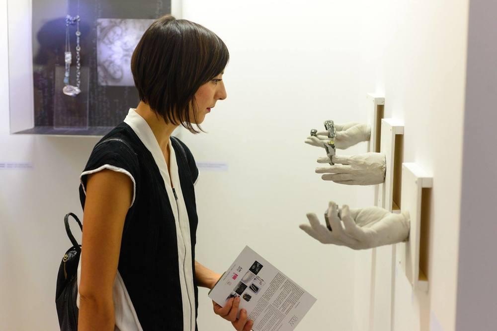 Anastasia Kandaraki (anticlastics) looking at Nikos Karakostas rings at everything flows exhibition-Orestis Rovakis photo credits