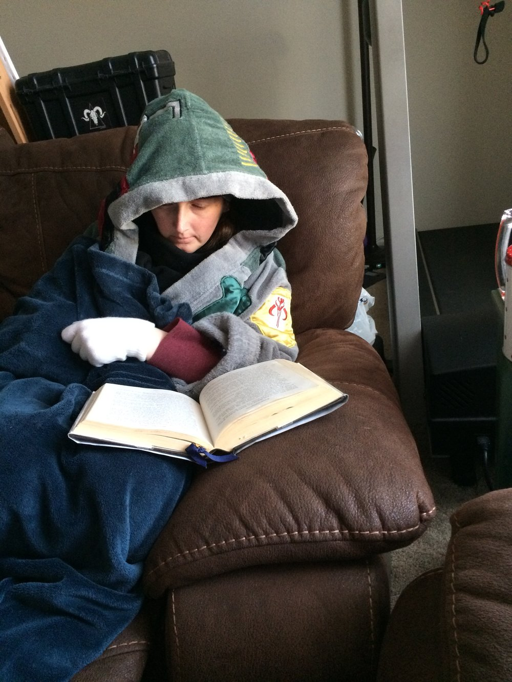 "Ahh, the coziness of being bundled up, reading a book. Or, am I ""miming"" reading a book? With white gloves, it's hard to be sure."
