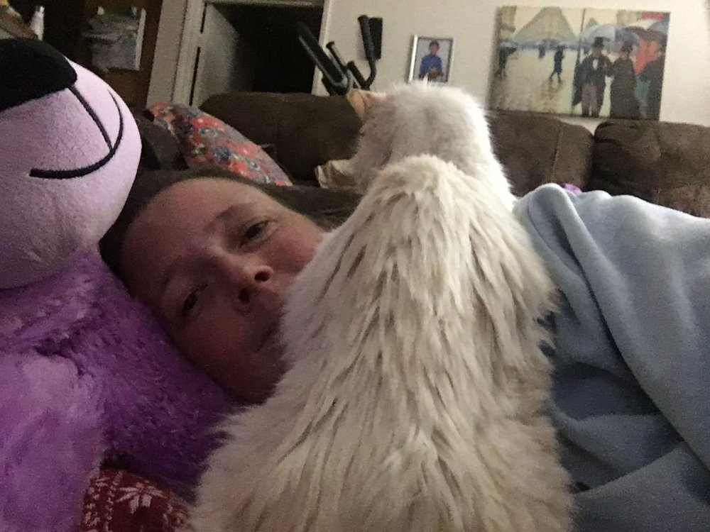 "Willow and I ""enjoying"" a nap."