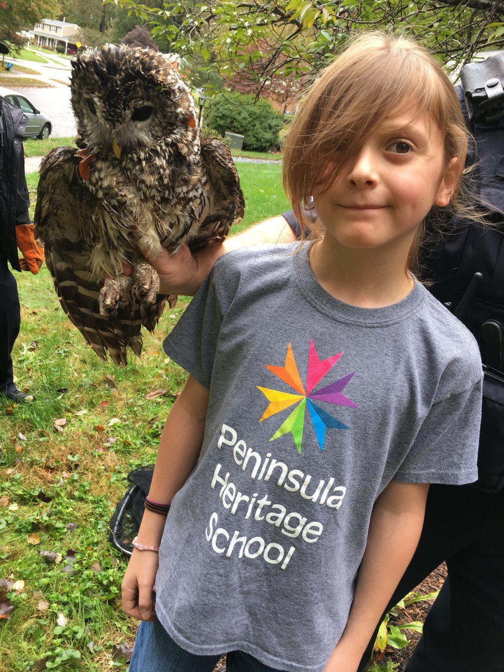 "My son with an owl ""on"" his shoulder. Yep, that's how long his hair is. Most of it is in a ponytail. Nope he won't cut it. Don't even ask. We've given up trying. Pretty cool looking owl though, right?"