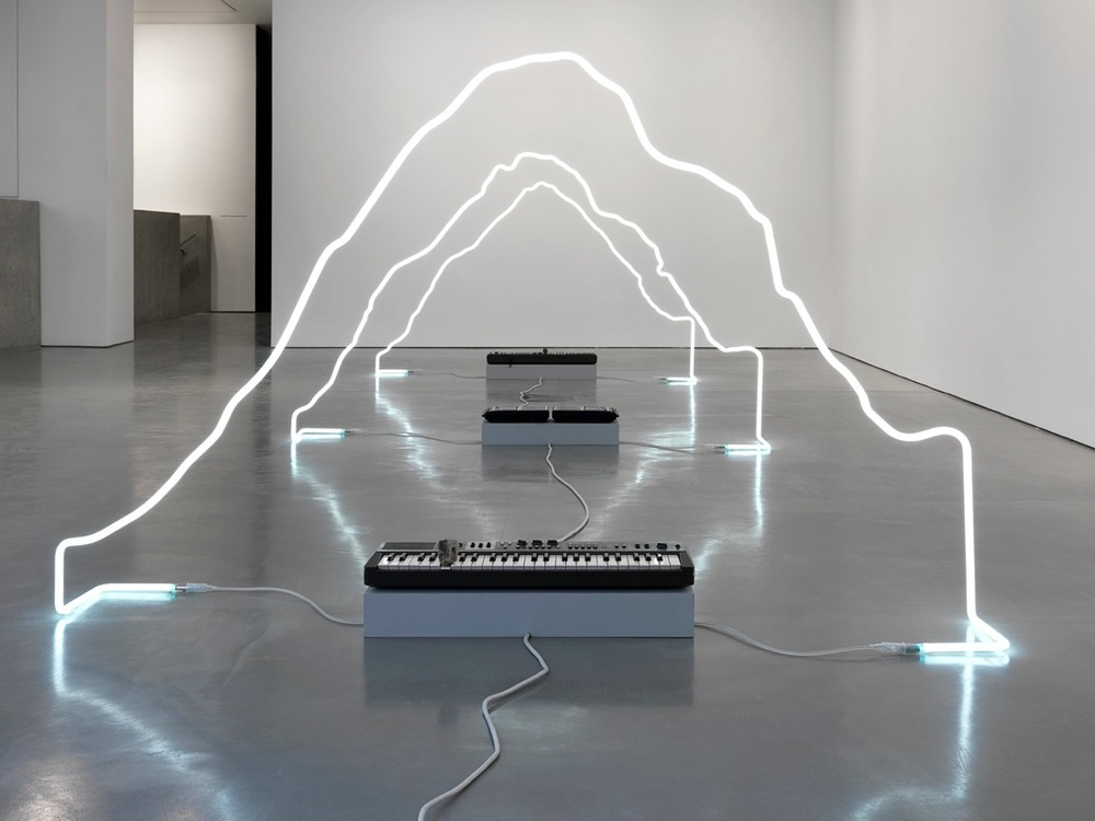 in defiance of being here, 2013  neon, Panasonic cassette recorders, cassettes, Casiotone MT-68 keyboards, rocks. dimensions variable